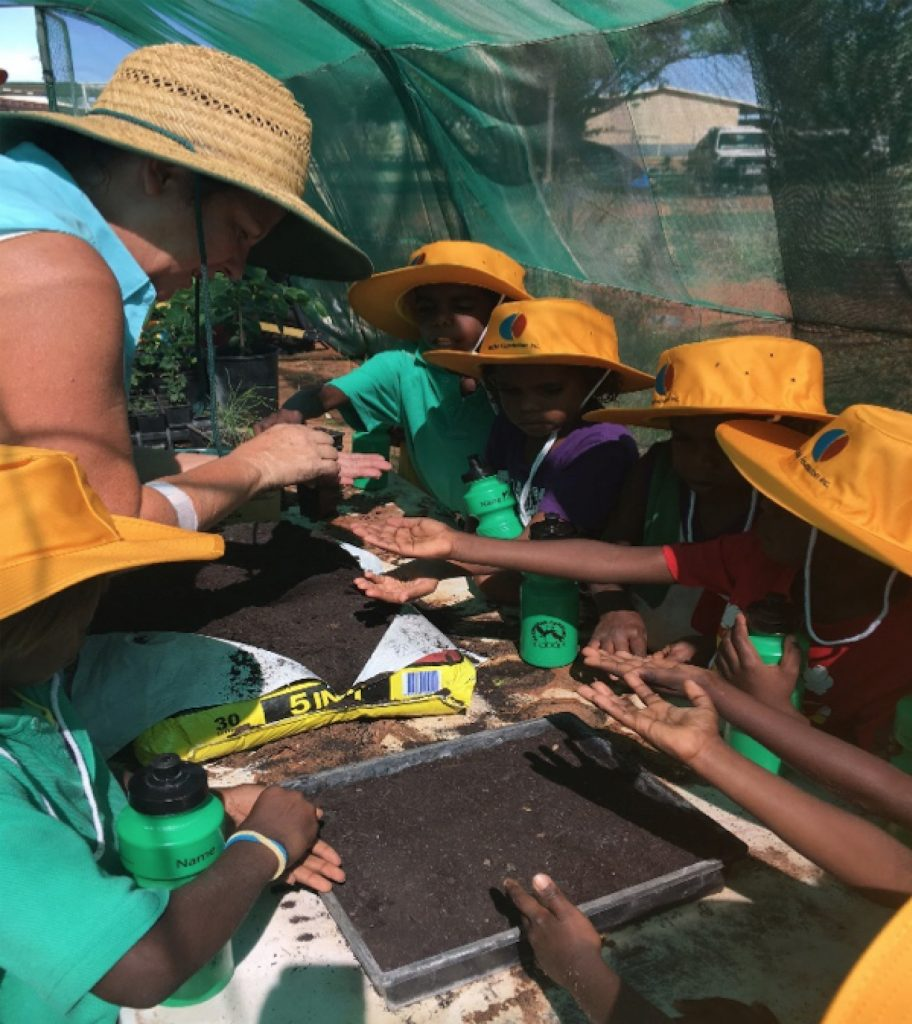 Yakanarra kids planting seeds - image credit EON